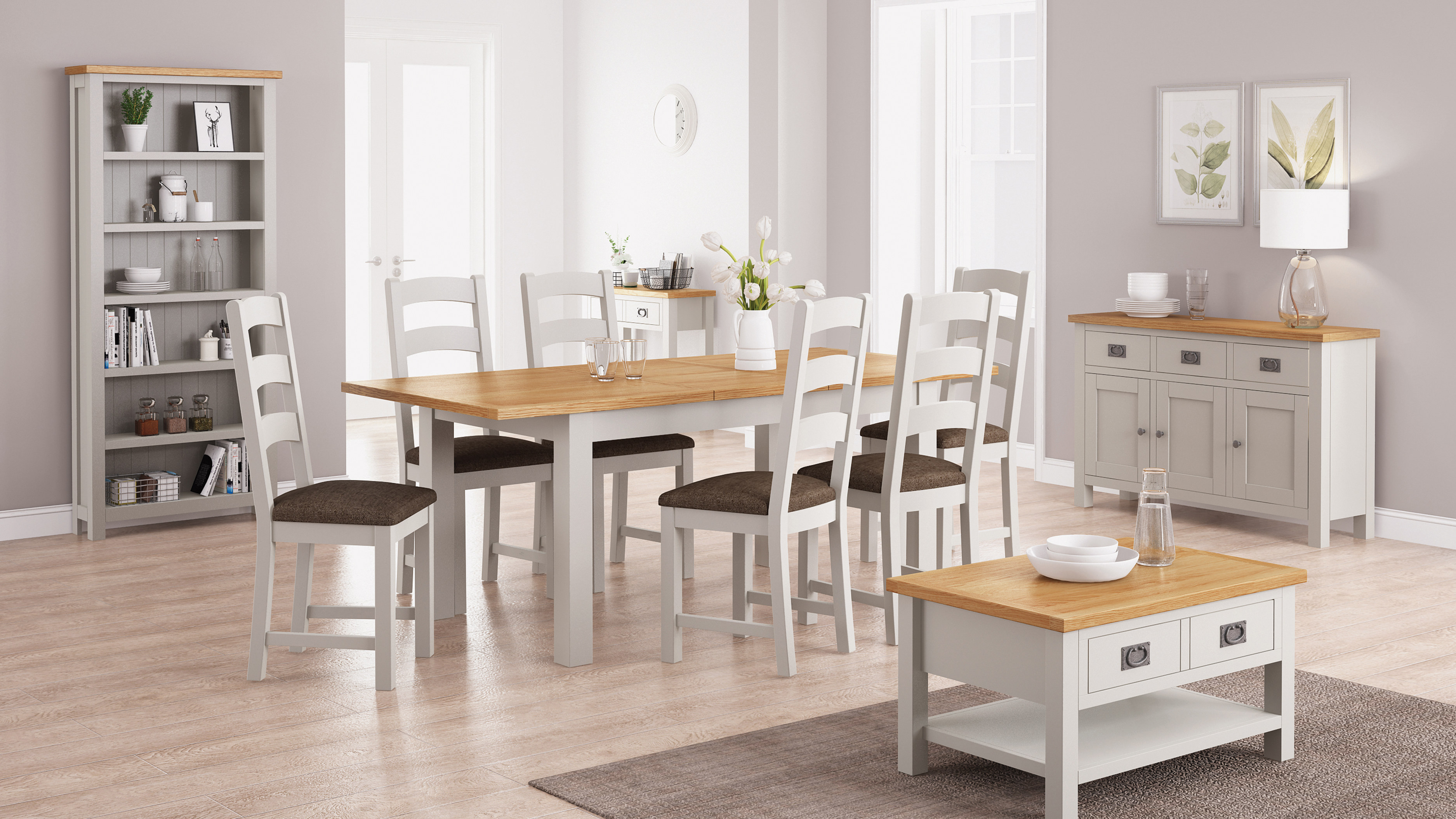 Rustique Home 100% Solid Oak Dining table with six chairs. The Chairs are soft cream color and the table is soft cream with natural oak color top.