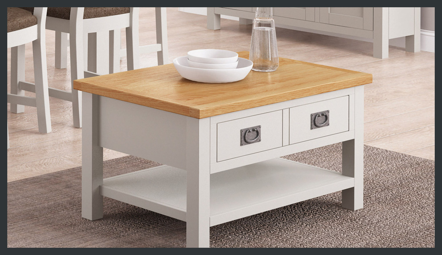 Rustique Home Florence Painted and Natural 100% Solid Oak coffee table. Two colors, main body is painted satin grey and the top is natural oak color. There are two drawers on the top and a shelf at the bottom for magazines.