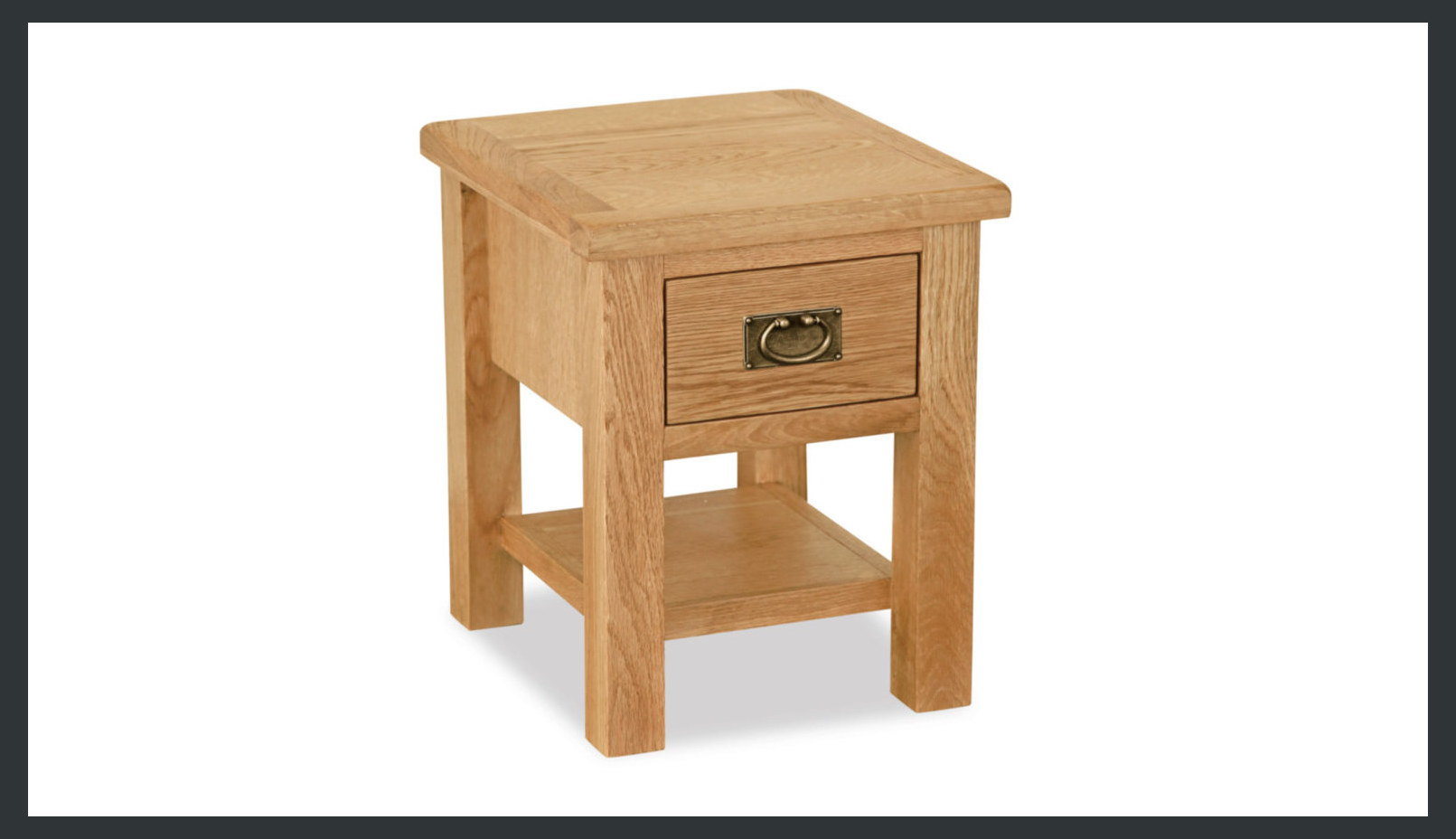 Rustique Home London Oak 100% Solid wood Lamp Table in natural oak color. Antique Metal handles. There is a drawer on the top and a shelf at the bottom for storage.