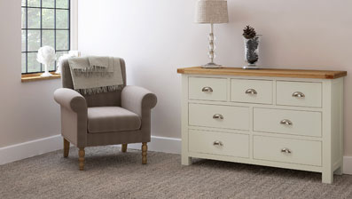 Two tone cream painted and rustic oak chest of drawers in living room